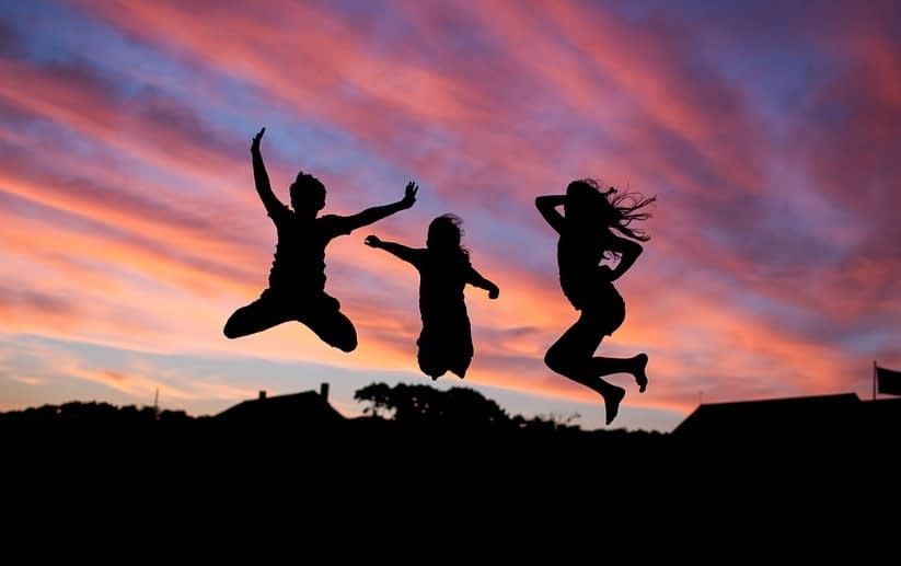 three people jumping in the air