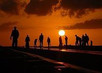 men working at sunset